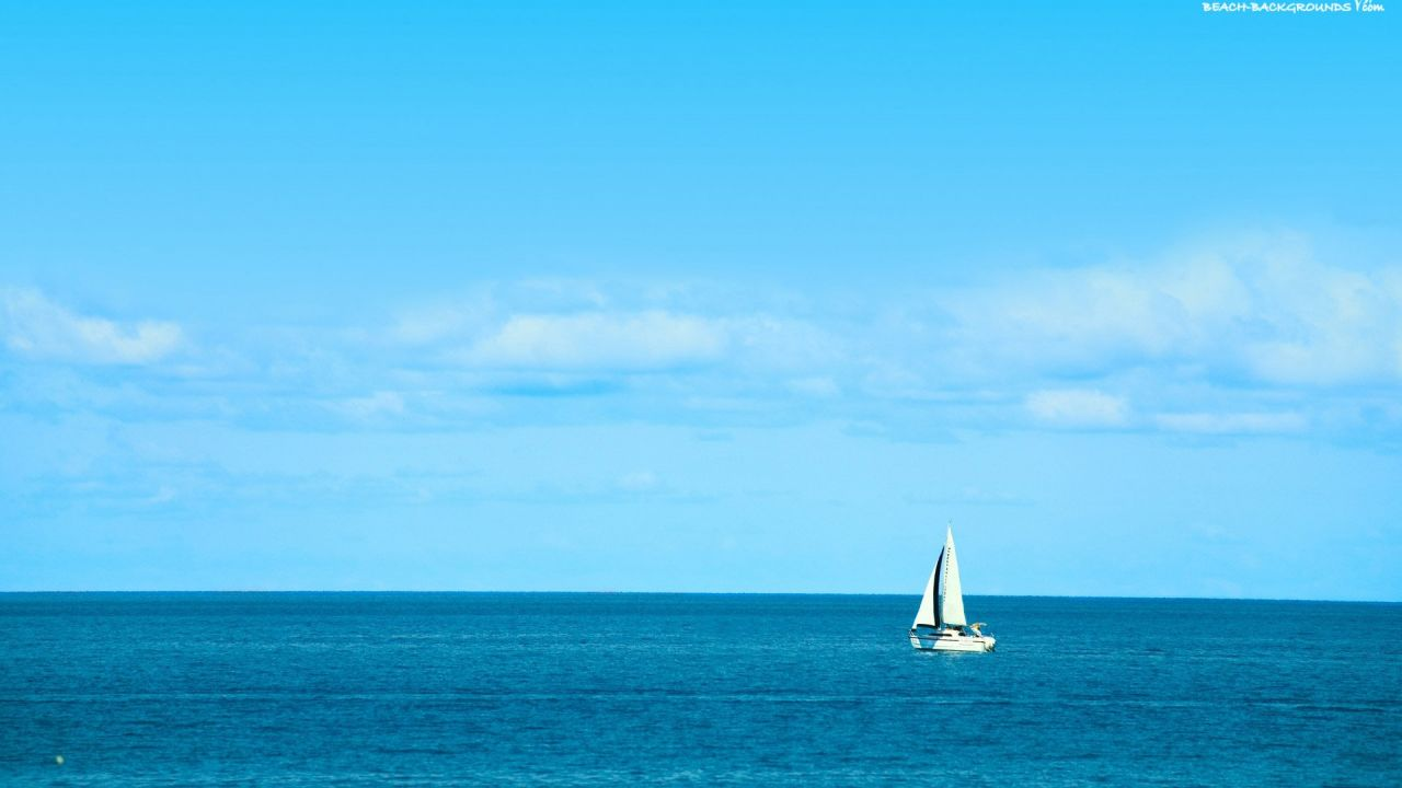 beach with blue Sailboat Background