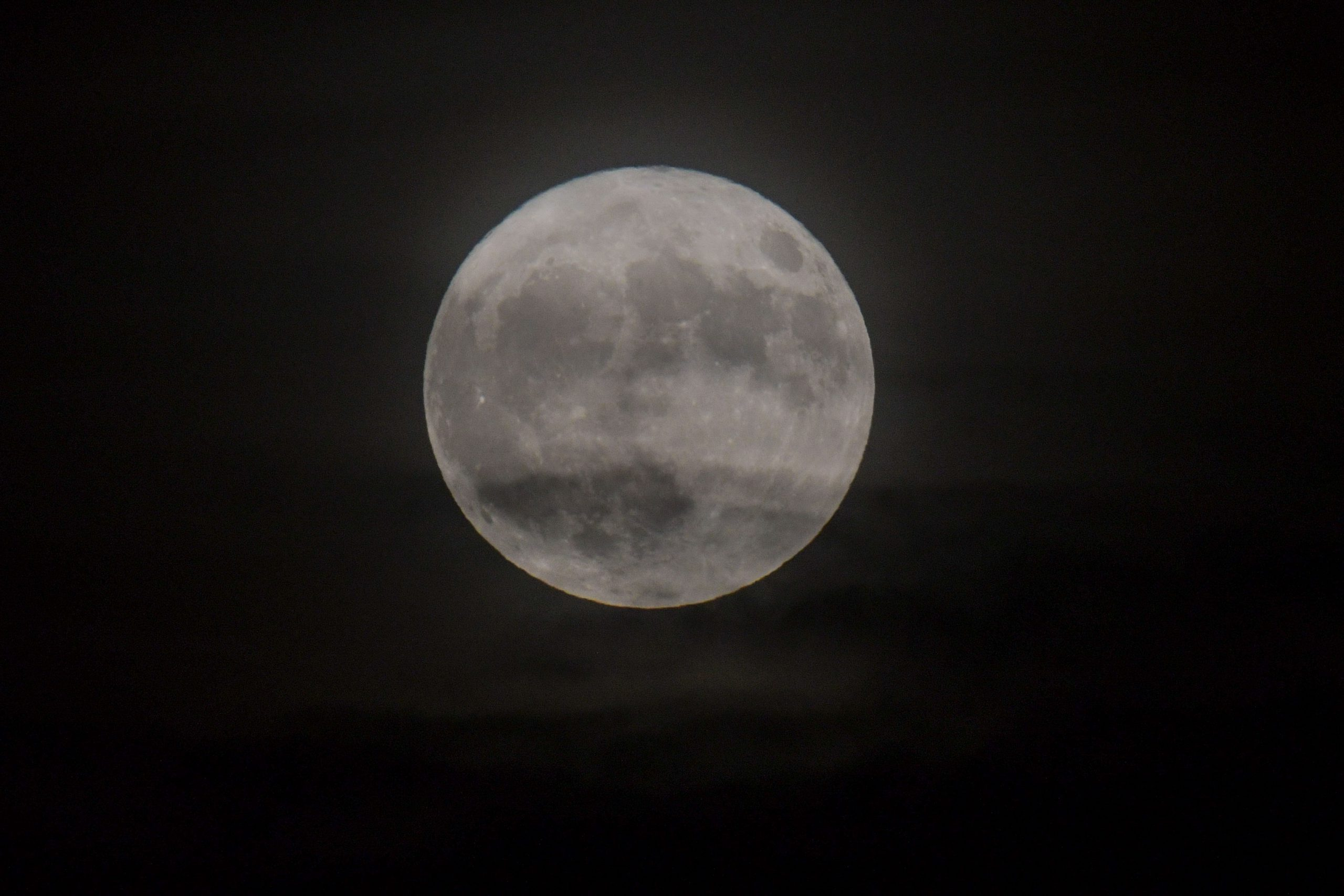 free natural Moon Covered in Clouds image